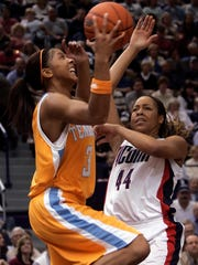 Tennessee's Candace Parker drives past Connecticut's Brittany Hunter for a shot in the second half of a basketball game in Hartford, Conn., on Jan. 6, 2007. Parker scored 30 points to help Tennessee defeat UConn 70-64.