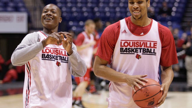 Louisville's Terry Rozier, left, and Wayne Blackshear