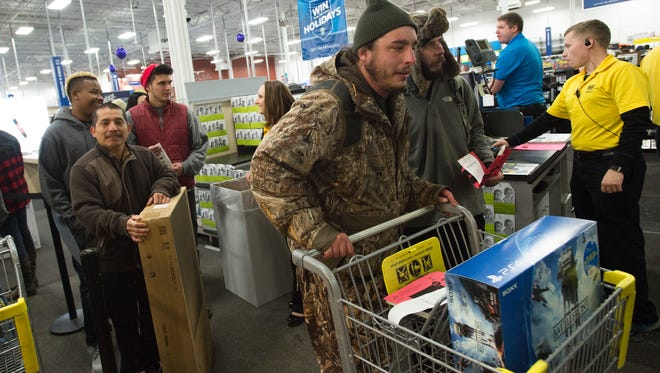 Customers purchase electronics at Best Buy during a Black Friday promotion. Black Friday sales helped push Fort Collins sales tax collections up nearly 5 percent for the year.