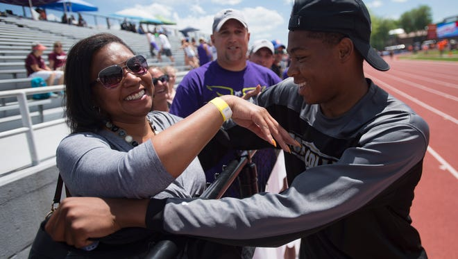 Micaylon Moore of Fort Collins High School celebrates with his mother, LaKendrea, after winning a state title in the 5A long jump during the CHSAA State Track and Field Championships at JeffCo Stadium in Lakewood on Thursday.