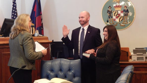 William H. McDermott takes his oath of office as the