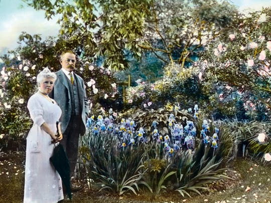 """This 1914 hand-tinted photograph of Admiral Aaron Ward and his wife, Elizabeth, in Roslyn Harbor, N.Y., was take taken by photographer Frances Benjamin Johnston. It is included in the exhibition, """"Groundbreakers: Great American Gardens and The Women Who Designed Them."""""""