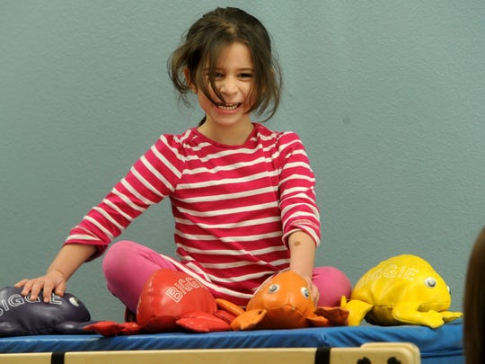 Speech therapy becomes a game for Katherine Rosenthal, of Camarillo, at the new Easterseals facility in Oxnard.