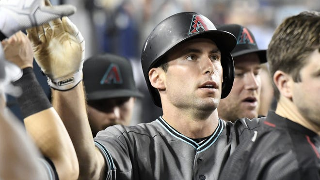 Diamondbacks first baseman Paul Goldschmidt is greeted in the dugout after scoring a run during Friday night?s game against the Los Angeles Dodgers. Visit dbacks.azcentral.com for a recap of the late matchup. Jul 29, 2016; Los Angeles, CA, USA; Arizona Diamondbacks first baseman Paul Goldschmidt (44) is greeted in the dugout after scoring a run against the Los Angeles Dodgers in the seventh inning at Dodger Stadium.