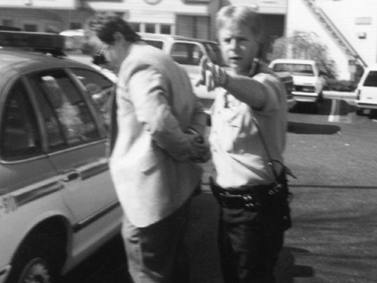 Pensacola Police officer B.E. Ski Jablonski handcuffs Michael Griffin after he shot and killed Dr. David Gunn on March 10, 1993.