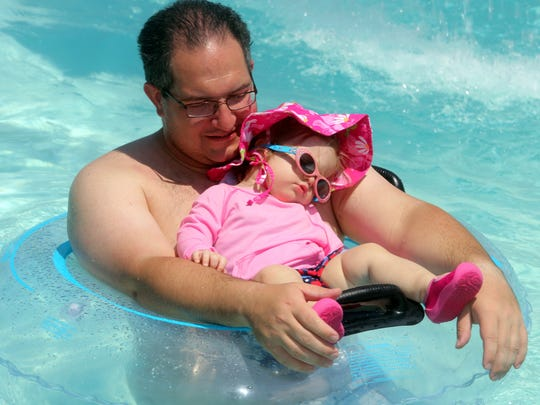 Rob Labarbera of Yonkers holds tight to his 15-month old daughter Emma, as they spend a hot afternoon in the pool at Tibbetts Brook Park in Yonkers July 21, 2016. Thursday was Emma's first visit to the pool at Tibbetts, and it was clear that nothing was coming between her and her afternoon nap. Forecasts for the next few days call for increased temperatures along with high humidity.