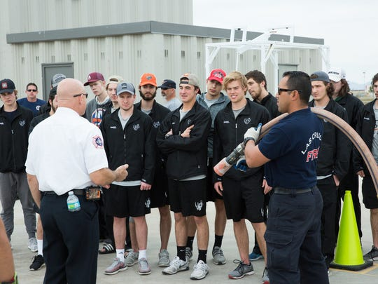 Ron Schulmeister, Las Cruces Fire Department Training Officer,left, gives the El Paso Rhinos Hockey team the run down of the training course at the LCFD training facility. Saturday, February 18, 2017.