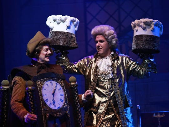 """Jeff Raum as Cogsworth and Christopher Mahr as Lumiere in """"Beauty and the Beast."""""""
