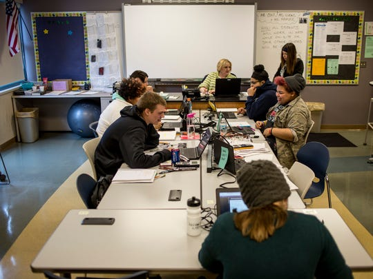 Students sit together in a classroom as they work on assignments Feb. 15 at the Virtual Learning Academy of St. Clair County.
