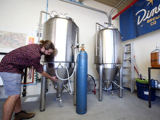 Chris Sheldon, owner of Diner Brew Co., gives a tour of his new hard cider brewery in Mount Vernon Sept. 25, 2017.