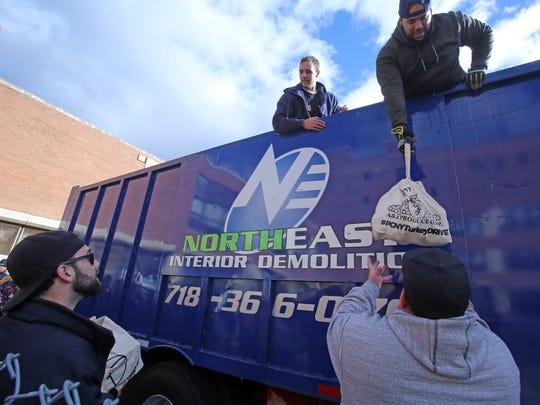 Volunteers with Precision Concierge New York unload