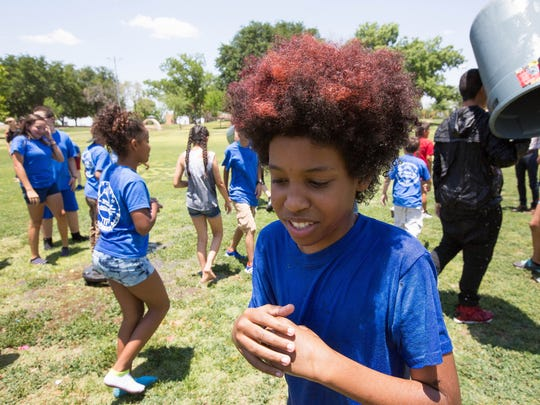 Amun Pichon, 12, shivers after water was poured on him during a water balloon fight at Young Park Thursday June 7, 2018. Pichon is a participant in the Las Cruces Police Department Youth Leadership Camp.