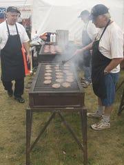 Burgers are prepared during Miesfeld's Lakeshore Weekend.