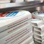 An animal welfare group is targeting Ann Arbor-based Domino's Pizza and other chains with its release of a video showing workers abusing cows at a farm that supplies milk for pizza cheese.