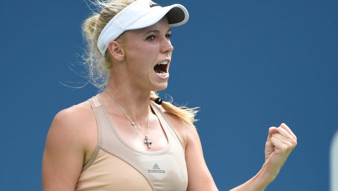 Caroline Wozniacki (DEN) reacts during the match against  Maria Sharapova (RUS) on day seven of the 2014 U.S. Open tennis tournament at USTA Billie Jean King National Tennis Center on Sunday.