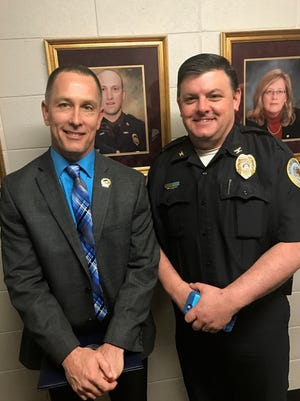 Henderson Police Department Chief Chip Stauffer poses with Major Brisco Edwards.