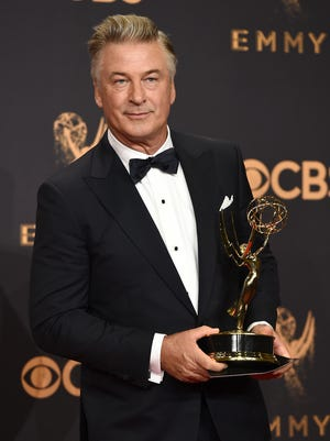 Alec Baldwin poses in the press room with the award for outstanding supporting actor in a comedy series for 'Saturday Night Live' at the 69th Primetime Emmy Awards on Sept. 17, 2017.