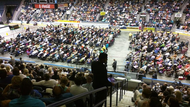 "The Jehovah Witnesses met Friday to discuss the keys to family happiness during their 2015 ""Imitate Jesus!"" Convention at Germain Arena. The event continues through the weekend."