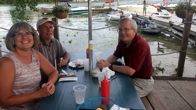 My friends Patty and Dave and husband Jack, enjoying an entertaining dinner at the Bay Side. (M. Rosenberry)