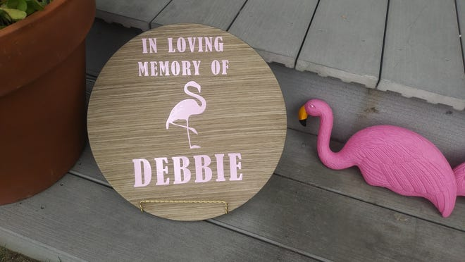 A flamingo sign shows the fondness Debbie Olsen had for the pink plastic birds.