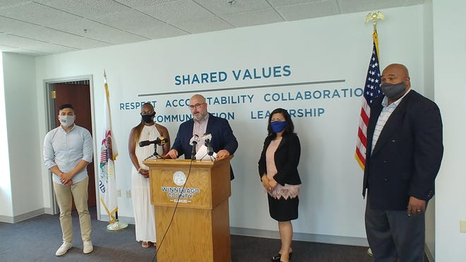 Winnebago County Board Chairman Frank Haney, at the podium, introduces Cesar Sanchez, from left, Rhonda Greer Robinson, Paulina Sihakom and the Rev. Peter Frank Williams at a news conference Tuesday at the Winnebago County Administration Building.