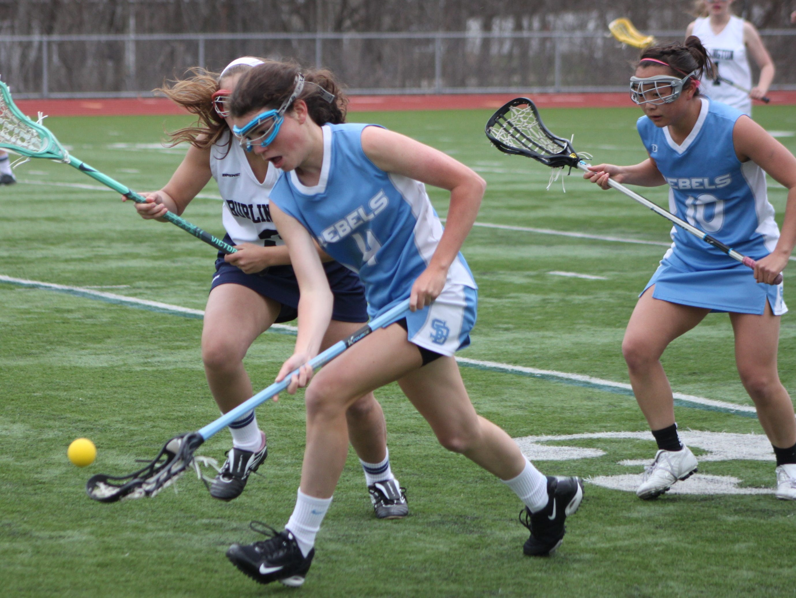 South Burlington's Mia Wood scoops up the ball during a girls lacrosse game at Burlington High School earlier this season.