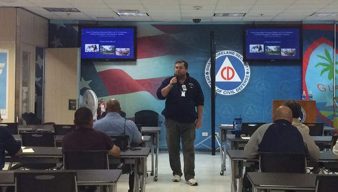 FEMA officials and Guam Homeland Security/Office of Civil Defense conduct a briefing on June 16 to inform prospective entities that can provide assistance with emergency protective measures and infrastructure repair as a result of Typhoon Dolphin.