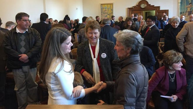 Maggie Toulouse Oliver, left, speaks to supporter Judy Williams of Santa Fe after taking the oath of office as New Mexico's secretary of state, at the New Mexico Supreme Court in Santa Fe, New Mexico, on Friday, Dec. 9, 2016. At center is Meredith Machen, president of the League of Women Voters of New Mexico.