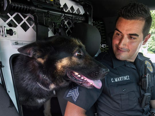 Sgt. Chris Martinez is shown in this 2015 photo with Tazer in the then newly outfitted Ford Explorer that was made just for K-9 duty, at the Newberry Township Police Department. A pass-through allowed Tazer to interact with Martinez in the front seat.