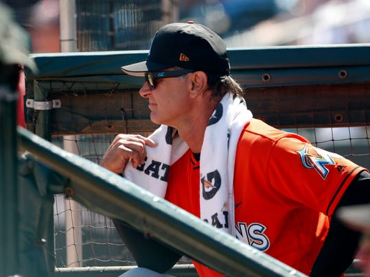 Miami Marlins manager Don Mattingly (8) watches from the dugout during a spring training baseball game against the St. Louis Cardinals, Friday, March 16, 2018, in Jupiter, Fla. (AP Photo/John Bazemore)