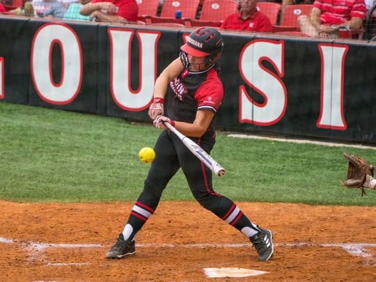 UL's Kourtney Gremillion takes a swing at the ball as the Ragin' Cajuns take on the ULM Warhawks in a weekend double-header at Lamson Park Saturday May 5, 2018.