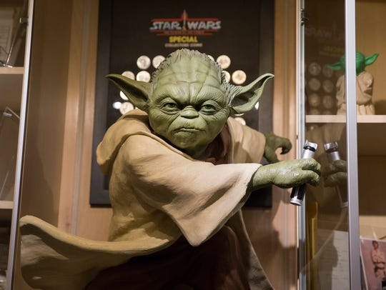 A large replica of Yoda seems to look over the Star Wars collection of brothers Ryan and Sean Lehmkuhl, who have amassed a large Star Wars collection.