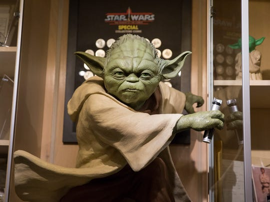 A large replica of Yoda seems to look over the Star Wars collection of brothers Ryan and Sean Lehmkuhl, who have amassed a large Star Wars collection. They now have one of the largest collections in Ohio, with over 7,000 items.