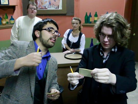 "Abron Lobato, left, and Talon Holmes rehearse a scene for the Theater Ensemble Arts production of ""Picasso at the Lapin Agile"" on April 15 at the TEA scene shop in Farmington."
