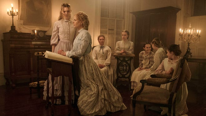 """Life in a Southern boarding school during the Civil War changes for the darker in """"The Beguiled"""" for Elle Fanning (from left), Nicole Kidman, Kirsten Dunst, Angourie Rice, Oona Laurence, Emma Howard and Addison Riecke."""