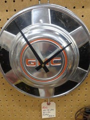 A clock made from vintage hubcap at Call It New/Call It Antique in Mesa.