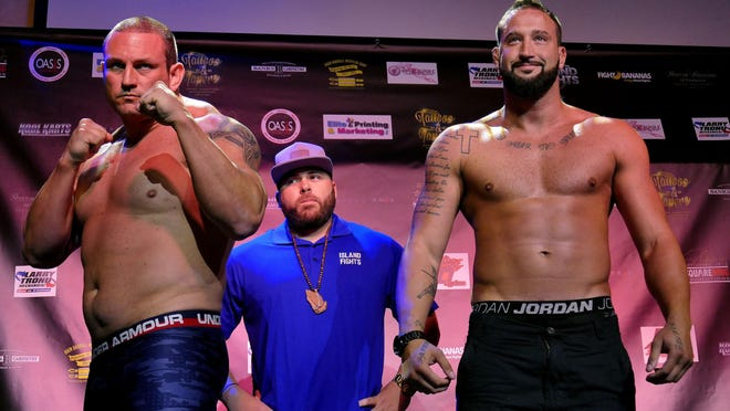 Dean Toole (blue shirt) during a weigh-in for past Island Fights event, has taken the venture from start-up in 2010 to Island Fights 40 on April 14 at Bay Center.