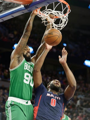 Celtics' Amir Johnson dunks over Pistons' Andre Drummond in the first quarter. The Pistons lost 104-98, ending a two-game win streak.