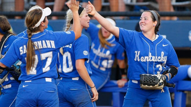 Kentucky's pitcher Kelsey Nunley, right, gives a thumbs-up to Nikki Sagermann after Kentucky defeated Louisiana-Lafayette 4-1 during the NCAA Women's College World Series softball tournament game in Oklahoma City, Thursday, May 29, 2014.  (AP Photo/Alonzo Adams)