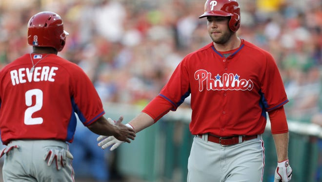 Philadelphia Phillies' Ben Revere (2)  is greeted by Darin Ruf after scoring on an RBI double by Marlon Byrd in the first inning of an exhibition baseball game against the Boston Red Sox in Fort Myers, Fla., Saturday, March 15, 2014. (AP Photo/Gerald Herbert)