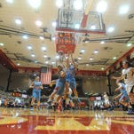 Players compete for a rebound during a semistate girls basketball championship game at Tiernan Center last March. The semistate returns to Tiernan Center this Saturday.