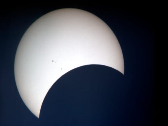 The eclipse is projected on the screen during a viewing