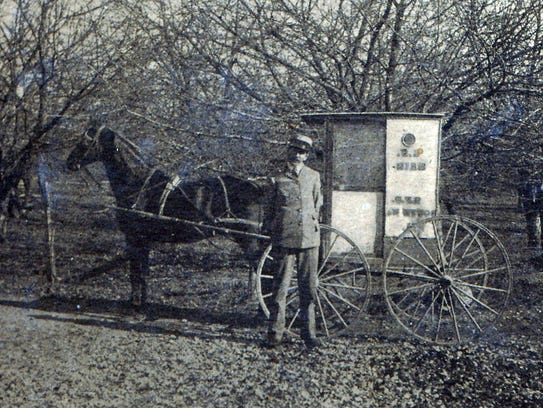 Postal employee David Zargar and his mail wagon that