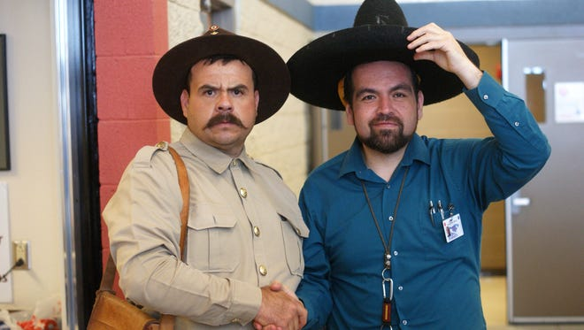 From left, Pancho Villa (as portrayed by Rafael Celestino) and Columbus Elementary School Principal Armando Chavez on March 8, 2018.