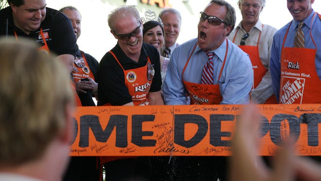 Home Depot store manager Rick Belli and Palm Springs Mayor Steve Pougnet saw wood instead of cutting a ribbon during the grand opening of the Palm Springs Home Depot in the Springs Shopping Center on April 2, 2008.