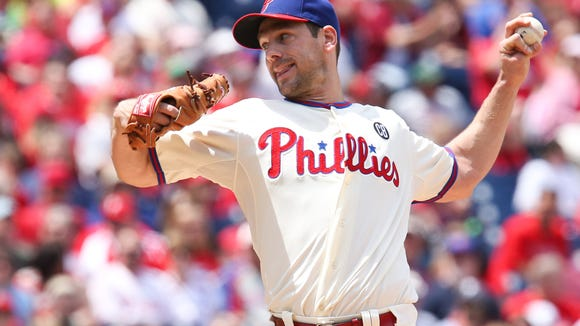 Philadelphia Phillies starting pitcher Cliff Lee (33) pitches in the first inning against the Cincinnati Reds May 18 at Citizens Bank Park. Credit: Bill Streicher-USA TODAY Sports