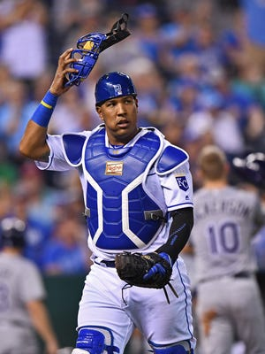 Kansas City Royals catcher Salvador Perez (13) heads to the dugout after the final out against the Tampa Bay Rays during the fifth inning at Kauffman Stadium.