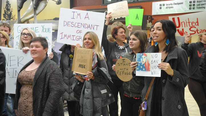 People protested President Trump's executive order on immigration at the Reno-Tahoe International Airport Saturday, Jan. 28, 2016.