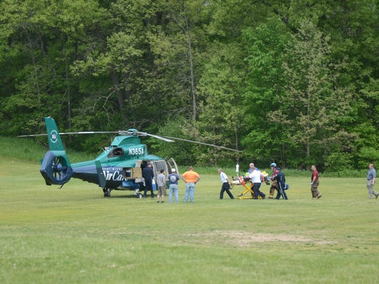 Rescue workers take the injured girl to a waiting AirCare