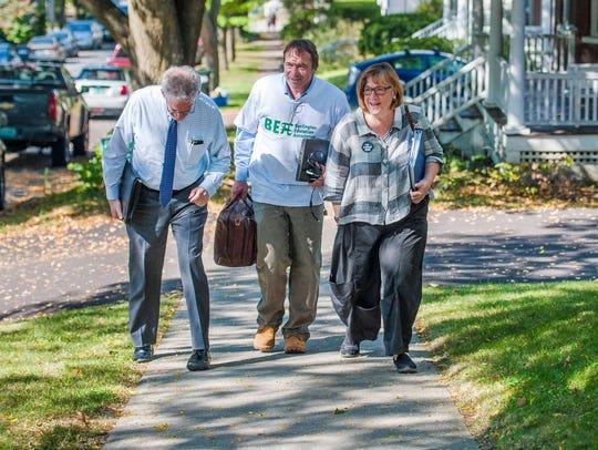 Mediator Ira Lobel, from left, walks with Bob Church